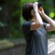 Woman looking through binocculars