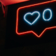 """Neon sign depicting a """"Like"""" button"""