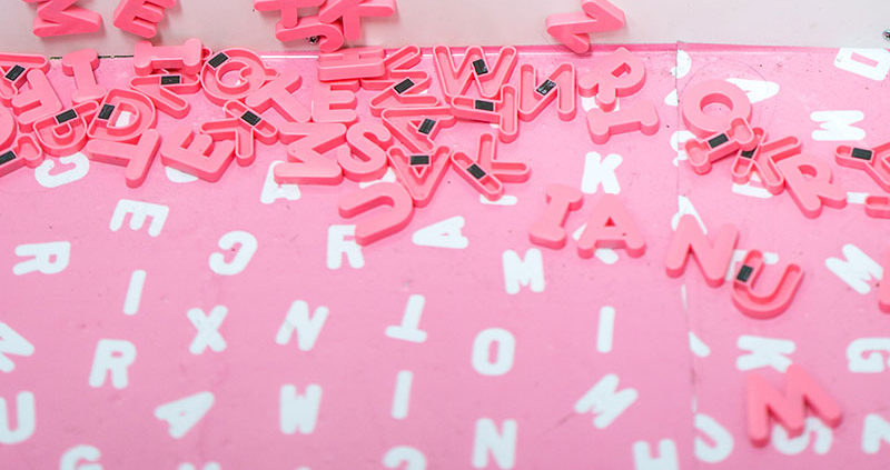 Magnetic pink letters piled together